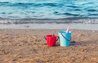 Child's bucket on empty beach
