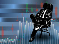 Silhouette of a man in a business suit sitting on the background of financial charts