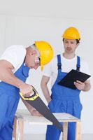 Builders in hardhats with tools