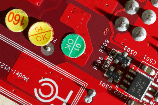 Electronic Printed Circuit Board in red with Electronic components- top view