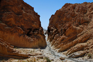 flow between tall mountains in the desert
