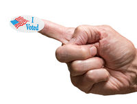 I Voted campaign sticker on finger of senior adult hand isolated against white