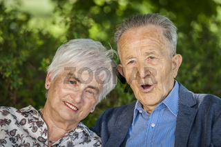 Portrait old retired couple mouth open