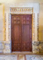 Wooden door in ornamental doorway