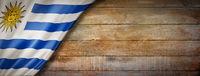 Uruguaian flag on vintage wood wall banner