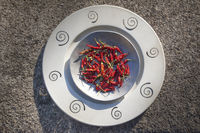 red peppers on two metal plates
