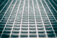 Closeup of an aged gray metal grid