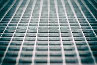 Closeup of an aged gray metal grid