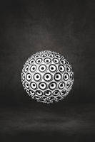 Speakers sphere on a black studio background