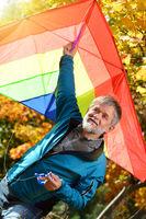 Elderly man with a kite
