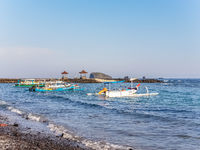 View of boat on Candidasa beach in Bali