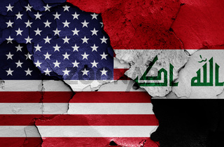flags of USA and Iraq painted on cracked wall