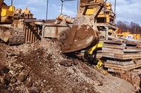 Bulldozer bucket. A bulldozer digs a hole
