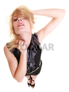 Sexy attractive blonde woman pulling her messy hair