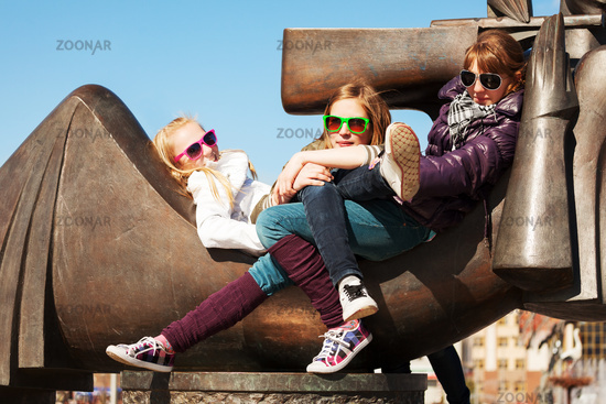 Teenage girls relaxing on the city street