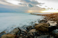 shroud of raging sea on a rocky shore