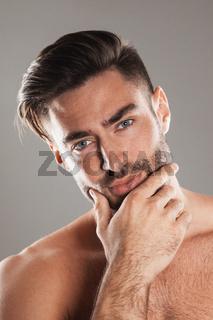 Portrait of man holding chin