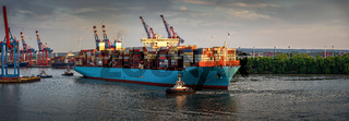 huge container ship at sunset in the port of Hamburg