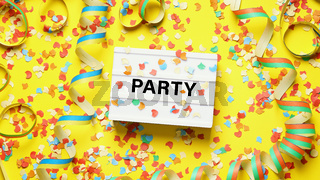 party celebration flat lay with confetti