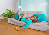 Woman laying on a sofa. Self isolation concept
