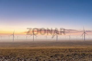 wind farm on autumn wilderness