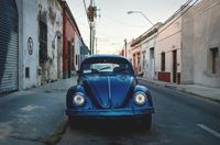 Old blue Volkswagen beetle in the colonial streets of Merida, Yucatan, Mexico