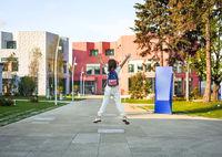 Girl with backpack walking to school