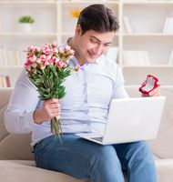 The young man making marriage proposal over internet laptop