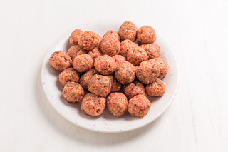 Raw meatballs on plate