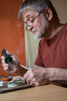 Elderly man concentrates at home