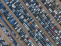 Top view of many parked cars waiting for shipping aerial drone view lined up structured