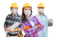 Female and Male Contractors In Hard Hats Wearing Medical Face Masks During Coronavirus Pandemic Isolated on White