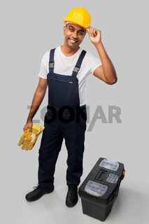happy indian builder in helmet with tool box