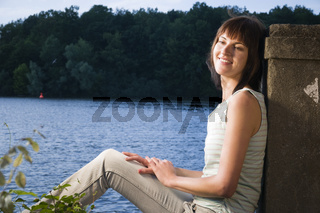 smiling lady by the river