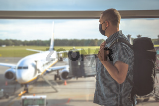 Man with a backpack waiting for departure in Covid19 time