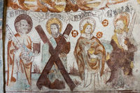 Medieval fresco of four apostles. St. Peter with a key, St. Andrew with a cross, St. John with a cha
