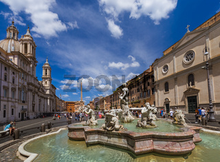 ROME, ITALY - AUGUST 11, 2016: Tourists walk by the fountain in Piazza Navona on August 11, 2016 in Rome Italy