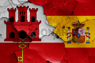 flags of Gibraltar and Spain painted on cracked wall