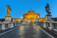 The Castel Sant Angelo and the Sant Angelo bridge in Rome at dawn