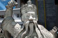 stone figure at Wat Phra Kaew ancient temple in Thailand Bangkok kings palace