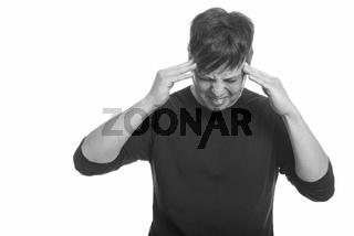 Studio shot of stressed man having headache