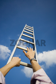 A businessman climbing a ladder