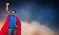 indian man in superhero cape over night sky