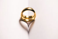 Golden wedding ring on book