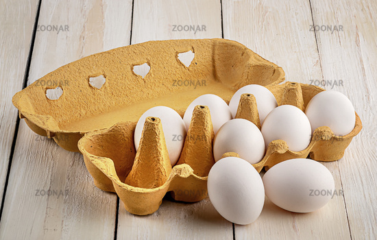 Eggs near the tray on white table