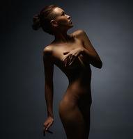 Full length photo of skinny girl posing nude