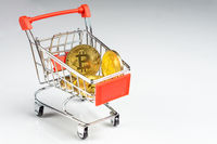 Bitcoin coins in a shopping cart