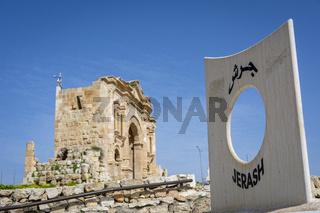 Gerasa, Jerash, Jordan: entrance of the historical roman ruins site of Gerasa in Jerash, Jordan, with the Arch of Hadrian in the background