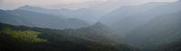 Summer misty evening mountain tops
