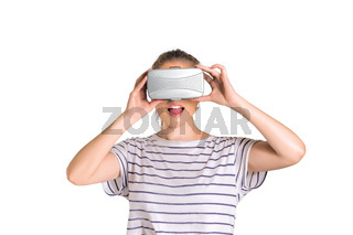 Young woman watching 3d interactive visualisation in virtual reality (VR) glasses. Isolated on white background
